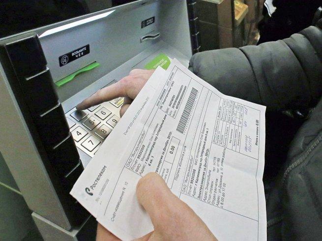 оплата задолженности по квартплате через терминал